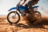 Man riding dirt bike in desert