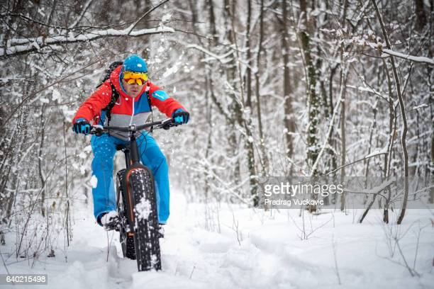 Man riding fat bike in the woods