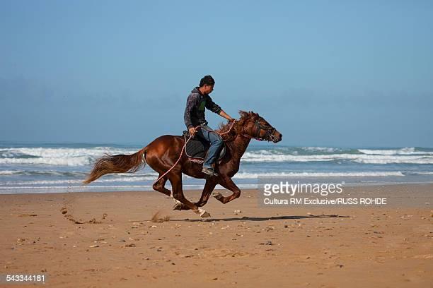 Man riding horse, Sidi Kaouki Beach, Essaouira, Morocco