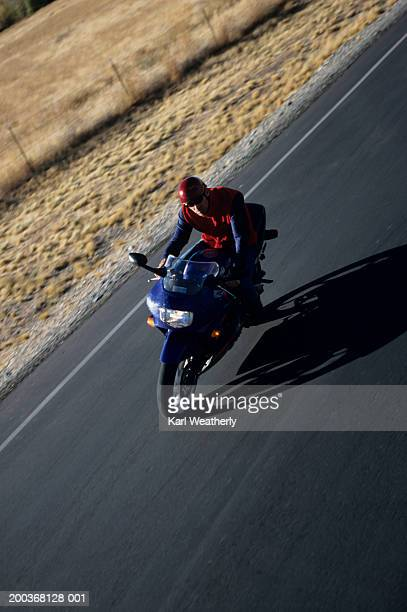 Man riding motorbike, elevated view
