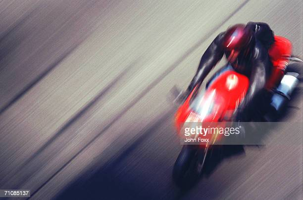 Man riding motorbike on street (blurred motion)