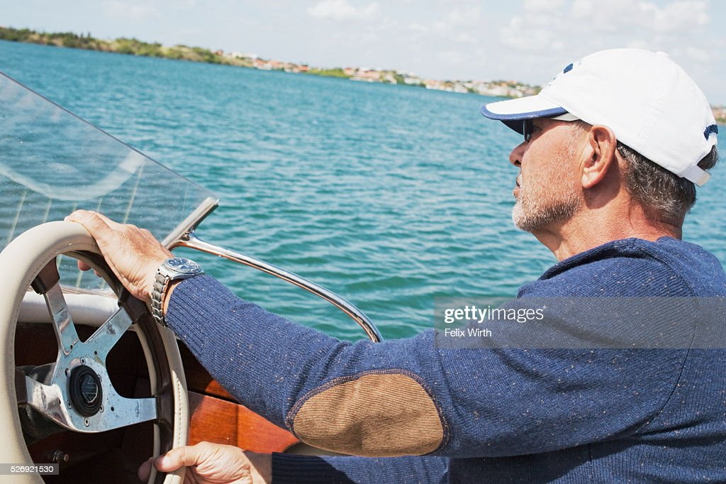 Man riding motorboat : Stock Photo