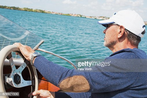 Man riding motorboat : Photo