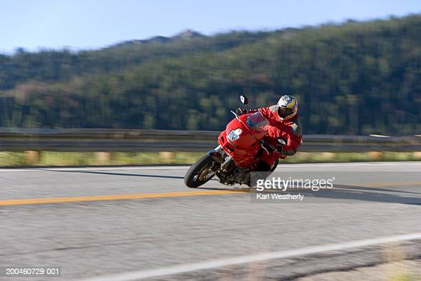 Man riding motorcycle around corner