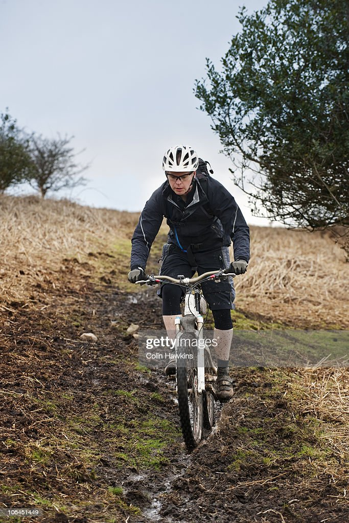Man riding mountain bike down hill stock photo getty images for Rose city motors fort wayne in