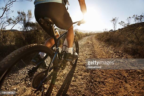 Man riding mountain bike in the countryside