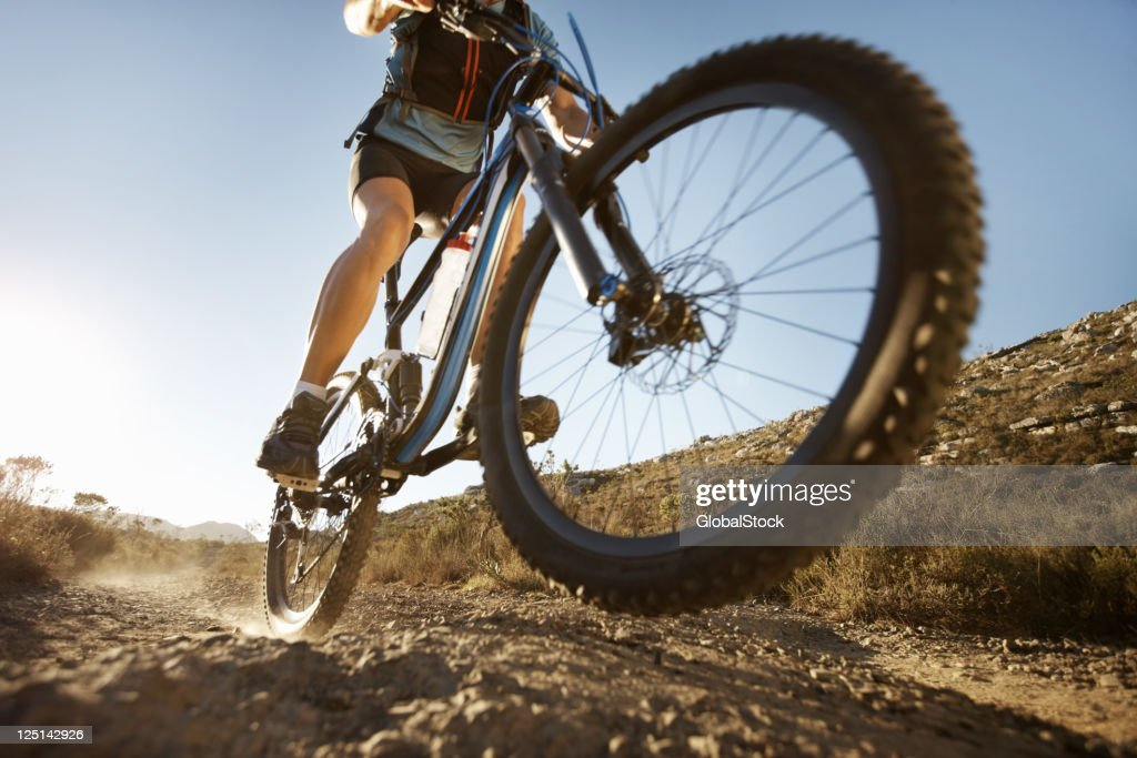 Man riding on single track trail : Stock Photo