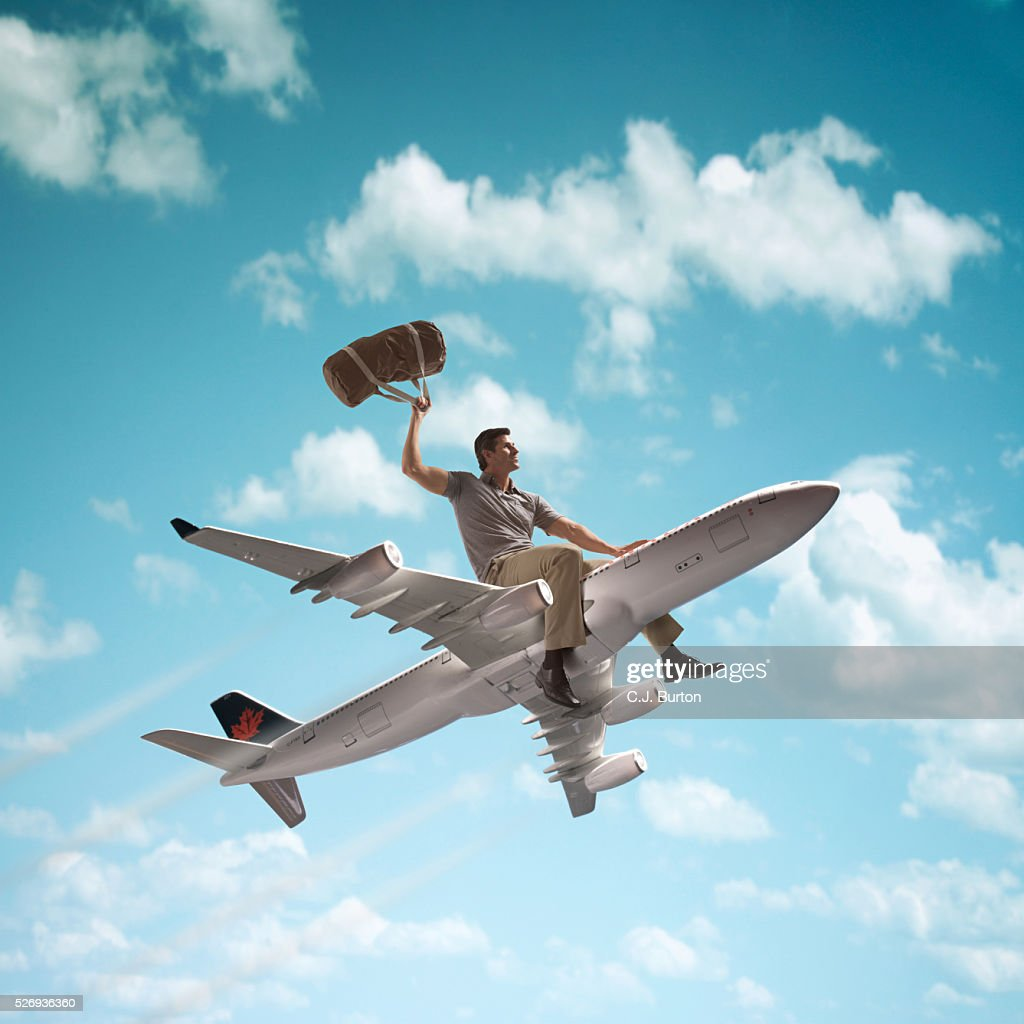 man riding on top of a jet plane stock photo getty images