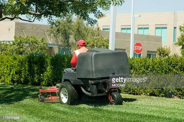 Man riding sit on lawnmower mowing grass