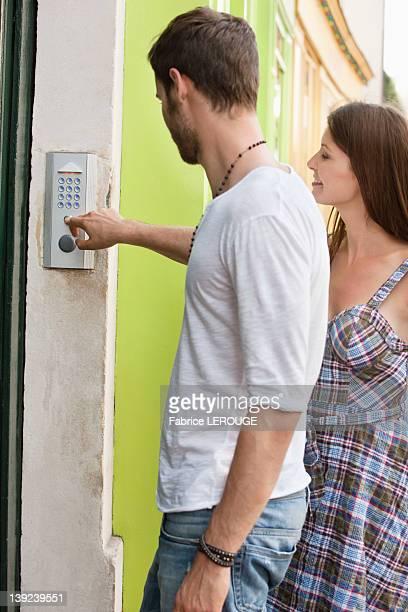 Man ringing a doorbell, Paris, Ile-de-France, France