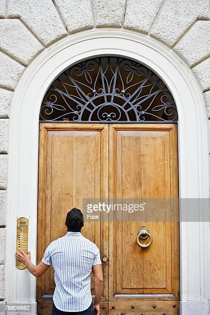 Man Ringing Doorbell