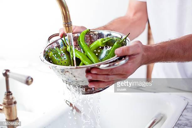 Man rinsing hot pepper