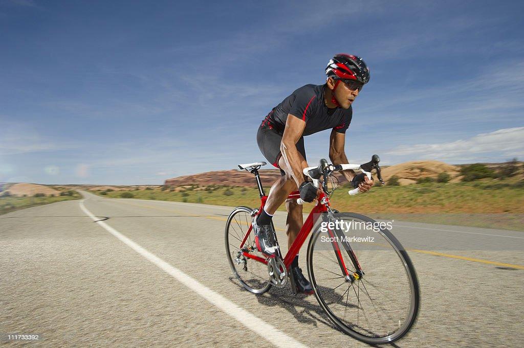 Man road biking, Moab, Utah. : Stock Photo