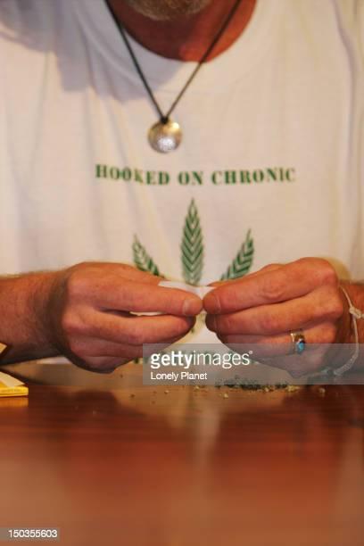 Man rolling marijuana cigarette at BC Marijuana Co-op, 307 W. Hastings Street.