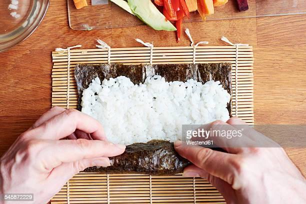 Man rolling sushi