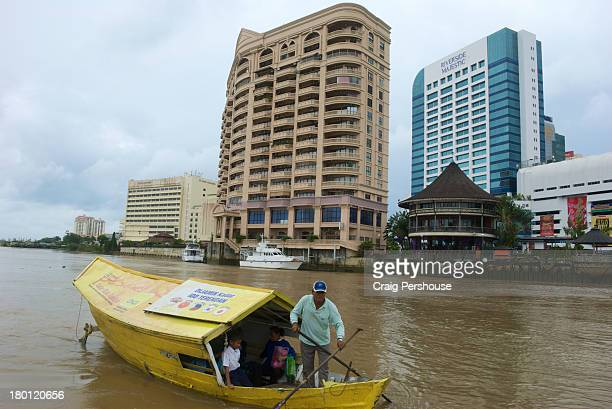 Man rowing a tambang (ferry) on the Sarawak River