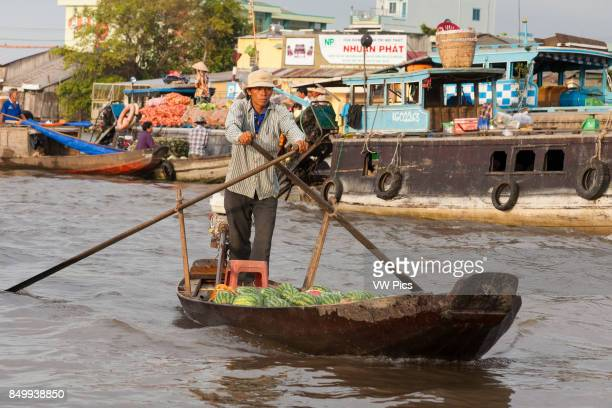 Man rowing his boat in the floating market Cai Rang near Can Tho Mekong River Delta Vietnam