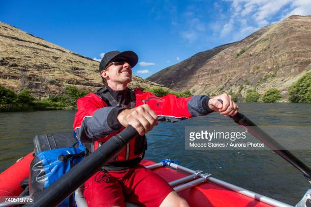 Man rowing on raft down Deschutes River