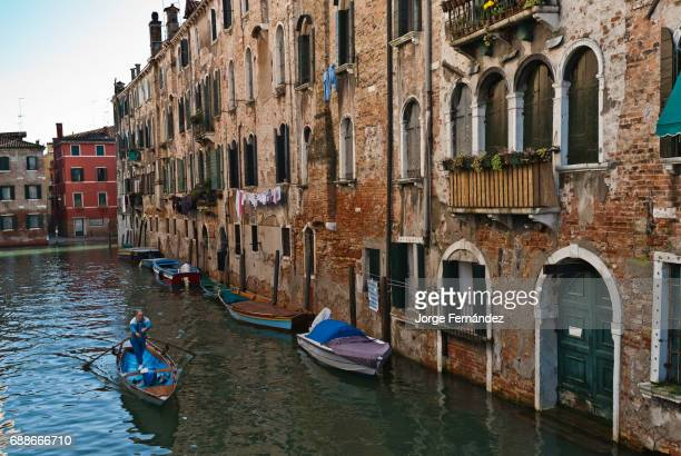 Man rowing on the canals of Venice