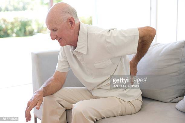 Man rubbing aching back
