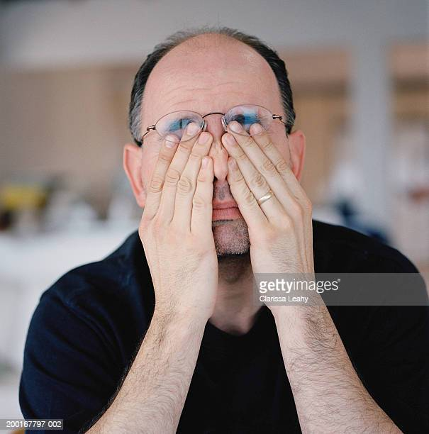 Man rubbing eyes, close-up
