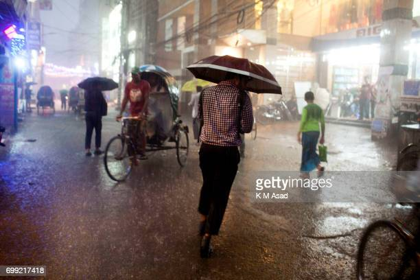 OLD DHAKA DHAKA BANGLADESH Man run middle in the rainwater when heavy rainfall made in Dhaka city The death toll rises to 150 in several hill...