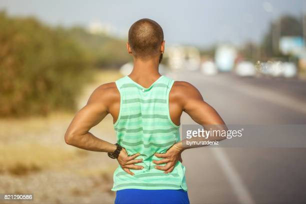 Man Runner lower back pain injury