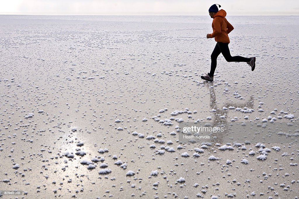 Man running across frozen lake
