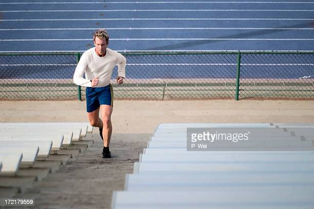 Man running bleachers to maintain health and strength