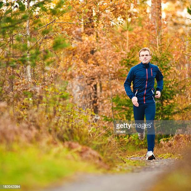 Man running in autumn trail