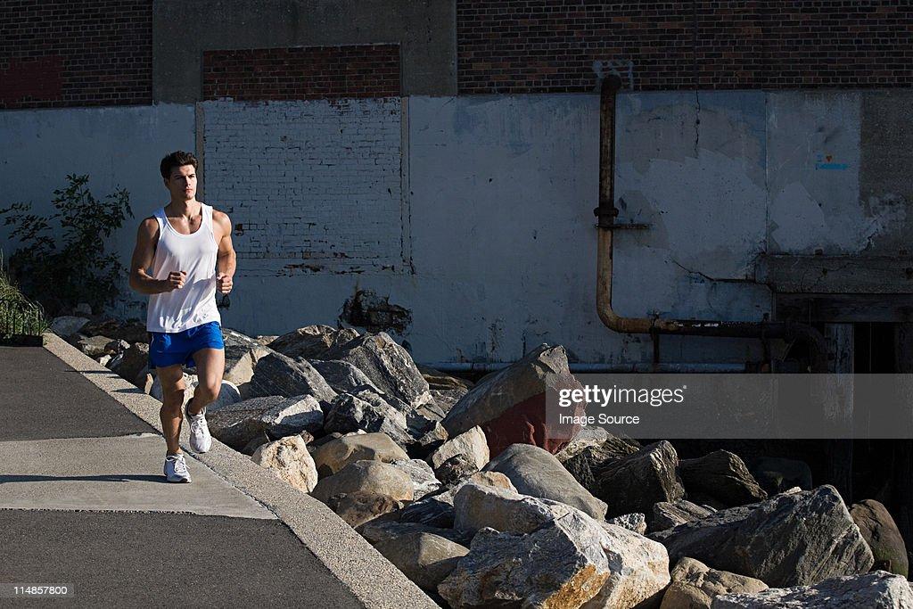 Man running in city : Stock Photo