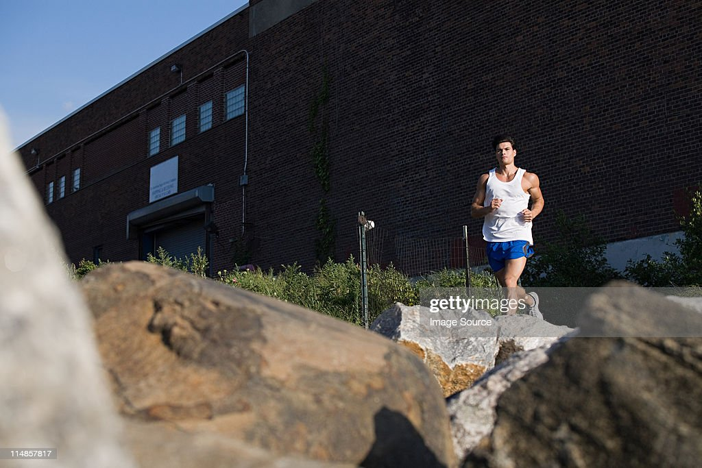 Man running in city : Stock Photo