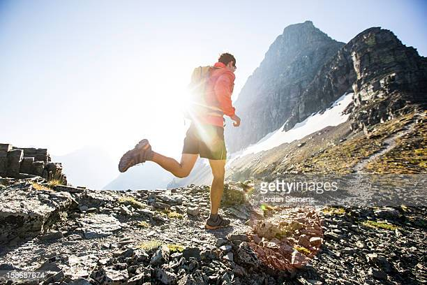 A man running in Glacier Park.
