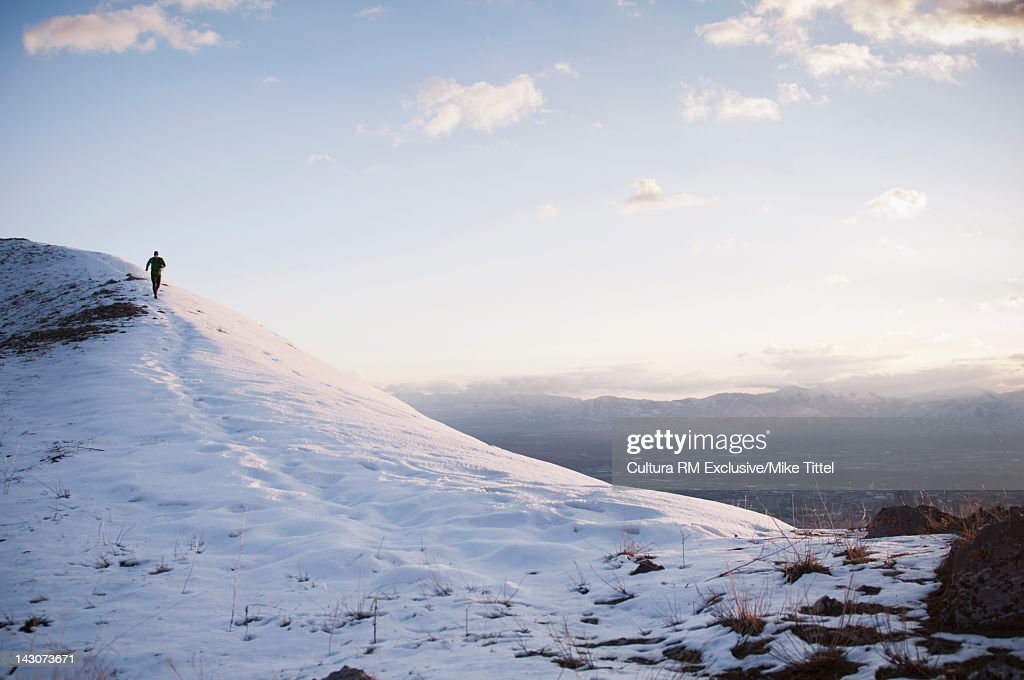 Man running in snowy landscape : Stock Photo