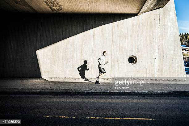 Man running in the city in early morning