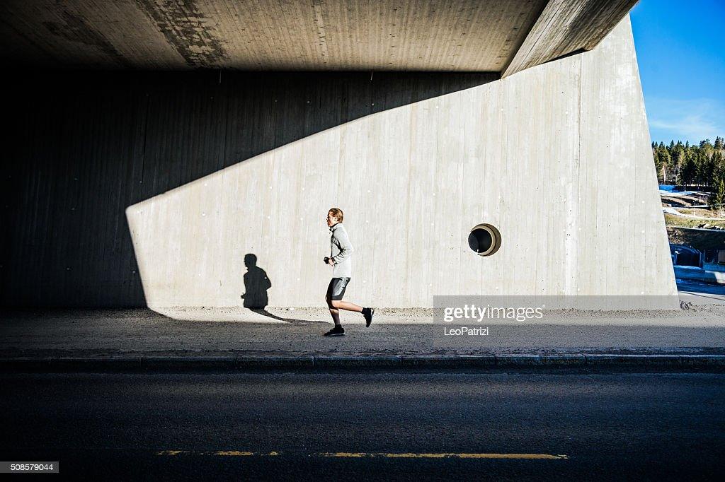 Man running in the city in early morning : Stock Photo