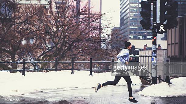 A man running in the winter snow