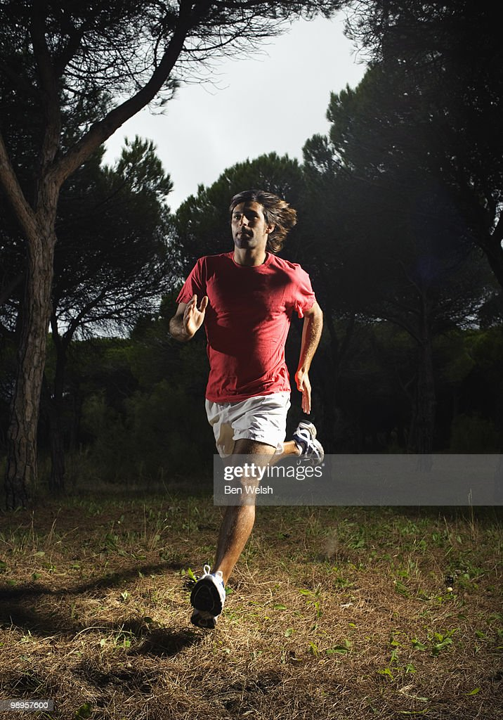Man running in the woods : Stock Photo