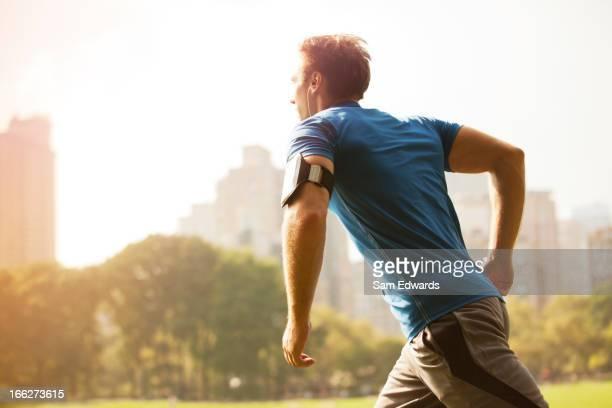 Man running in urban park