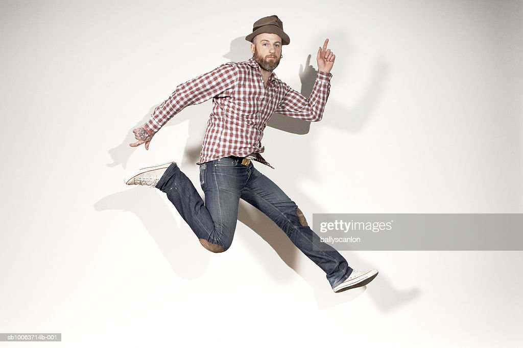 Man running mid-air, portrait : Stock Photo