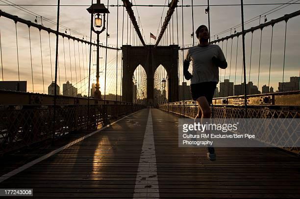 Man running on Brooklyn Bridge, New York City, USA