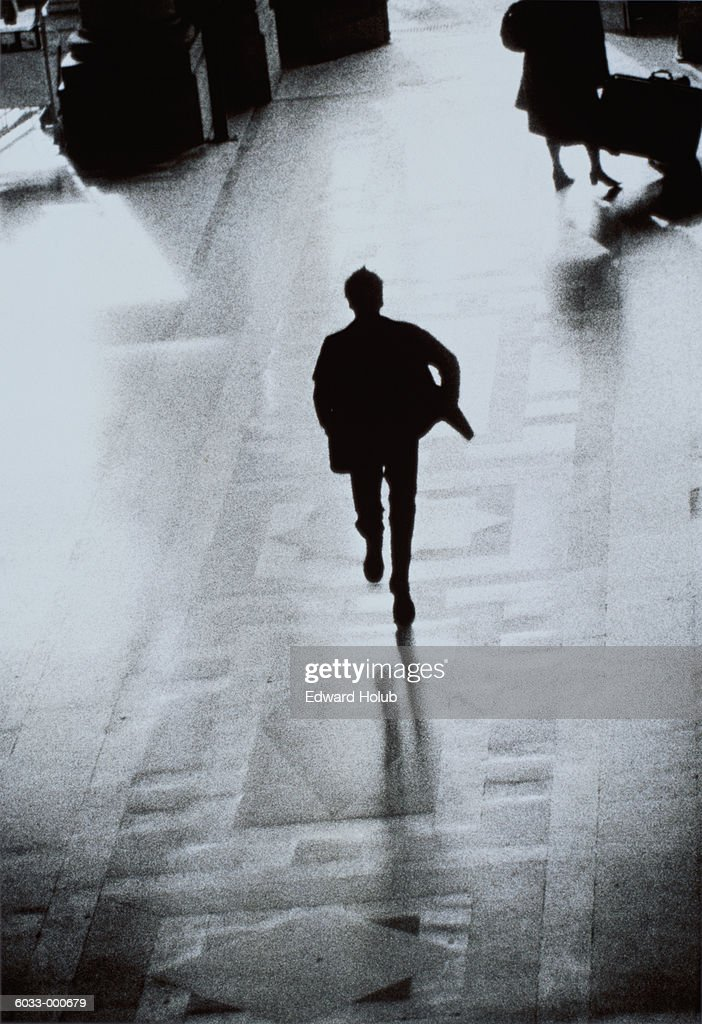 Man Running on Concourse