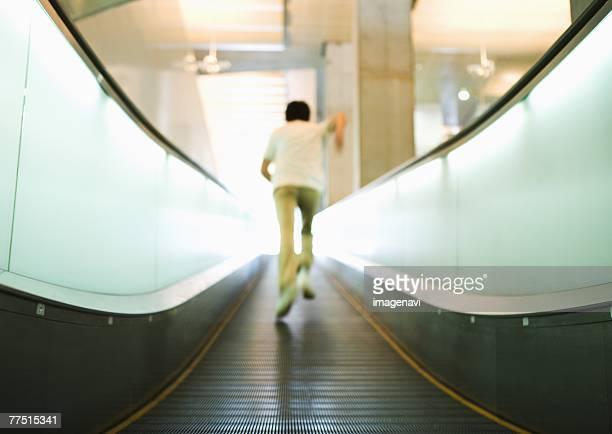 Man running on moving sidewalk