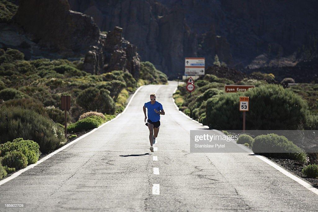 Man running on road near volcano Teide