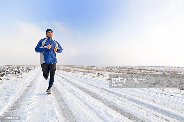 Man running on snowy winter road