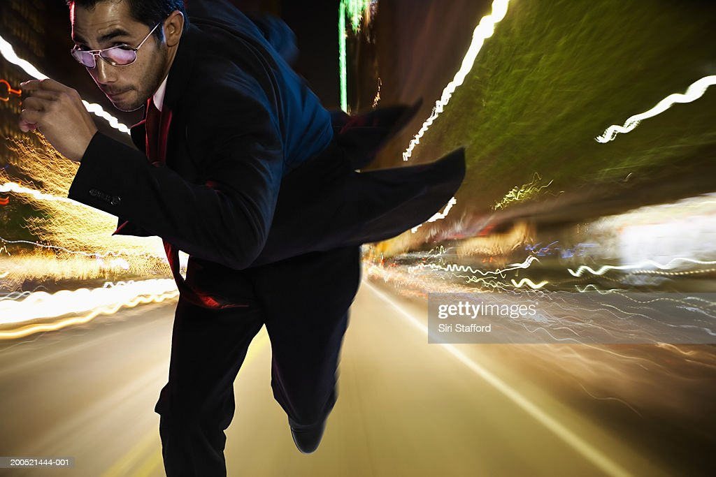 Man running on street at night (Digital Composite) : Stock Photo