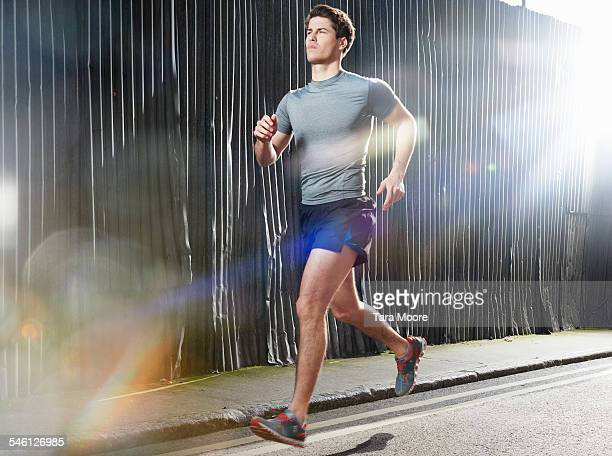 Man running on sunny street in urban setting