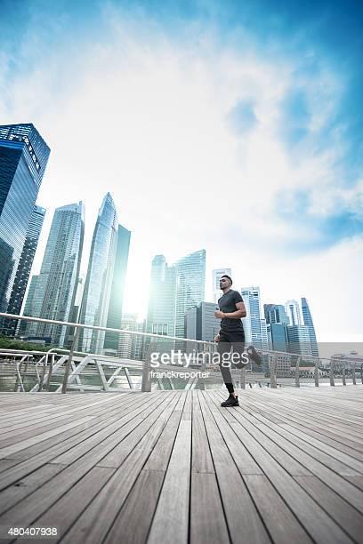 man running on the city of singapore marina bay area