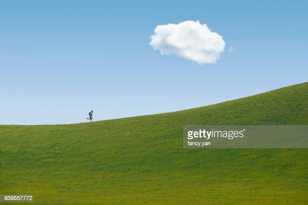 man running on the hill chasing dreams