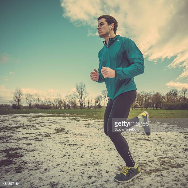 man running on winter day